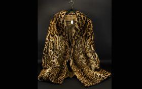 Full Length Ocelot Coat, approx size 12/14. Lovely Ocelot coat, hook and eye fastening.