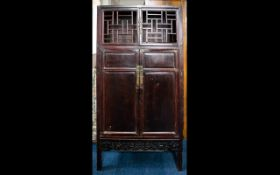 A Mid-Late 20th Century Oriental Style Cabinet Openwork lattice doors above panel doors with carved