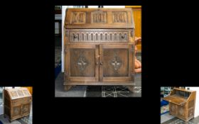 Oak Panelled Bureau of small proportions and typical form. Fall front with carved panel detail.