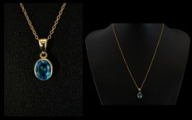 A Faceted Blue Topaz 9ct Gold Set Pendan