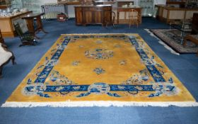 A Very Large Oriental Wool Rug Ochre ground with cobalt and sky blue borders and taupe/cream
