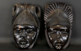 Two Carved Wood Wall Masks Ebonised wood masks,
