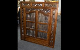 A Teak Feature Mirror With fretwork foliate surround ,