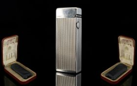 Dunhill 1960's Silver Rollagas Lighter, Comes with Original Red Leatherette Case and Papers.