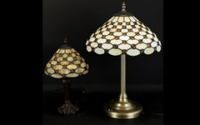Two Tiffany Style Leaded Glass Table Lamps Each with cream opalescent and amber cabochon detail