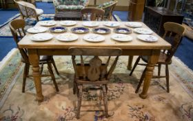A Pine Dining Table And Accompanying Chairs Rustic finish rectangular table raised on solid,