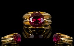 An Unmarked 18ct Gold And Ruby Ring Mounted with a blood red ruby coloured gemstone, est weight, 3.
