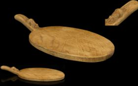 Robert Thompson Mouseman Hand Carved Oak Cheeseboard Of oval form with raised handle.