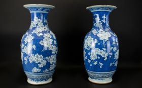 A Pair Of Chinese Antique Blue And White Vases Prunus blossom decoration throughout, unmarked base,