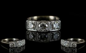 18ct White Gold Three Stone Diamond Set Ring Of Superb Quality Fully hallmarked for 750, the round