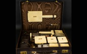 Art Deco Twelve Piece Travelling Vanity Set Each with gilt silver collars, hallmarked London 1941