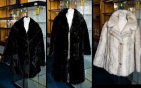 A Collection Of Three Vintage Simulated Fur Coats Each in good condition, each in plush faux fur.