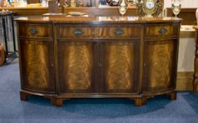 A 1980's Break Front Mahogany Sideboard Comprising central drawer above and between storage