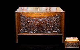 Antique Mahogany Adapted Coffer Blind fretwork style front with hinged, panelled top, raised on