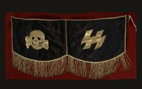 WWII Interest German SS Drum Flag Comprising red wool felt ground with brass hooks and black two