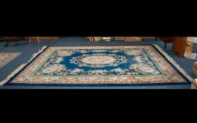 A Very Large Oriental Wool Rug Royal blue ground with triple border detail and oval floral and