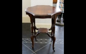 Early 20th Century Beechwood Occasional Table Fluted supports to cross stretcher raised on paw feet