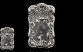 Art Nouveau Period Tulip Design Silver Hinged Vesta Case. Both lid and borders decorated in relief.