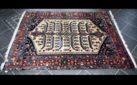 A Large Afghan Wool Rug Traditional heavyweight woven carpet with triple borders and central cream