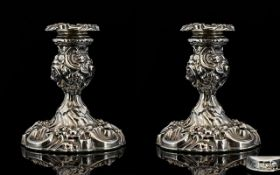Victorian Period Stunning Pair of Superior and Pleasing Ornately Embossed Pair of Candlesticks with