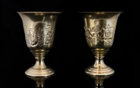 Two Middle Eastern Goblets White metal footed goblets with embosssed floral decoration to body.