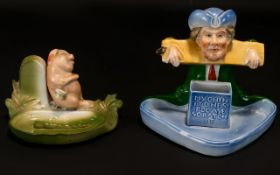 Two Early 20th Century Novelty Ashtrays Comprising blue glazed match holder/striker and ashtray