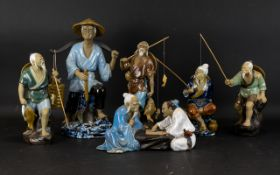 A Collection Of Modern Oriental Figures Six in total, each in the form of fishermen,