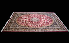 A Very Large Woven Silk Carpet Keshan rug with red ground and traditional Middle Eastern floral