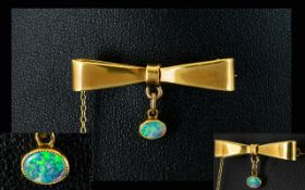 Antique Period - Pleasing 18ct Gold Bow Tie Brooch with Attached Opal Drop and Safety Chain.