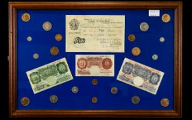 A Mounted and Framed Banknote and Coin Collection.