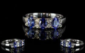 14ct White Gold Tanzanite and Diamond Set Dress Ring, Marked 14ct.