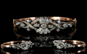 Antique Style 9ct Rose Gold Hinged Bangle Set with diamonds of excellent sparkle,