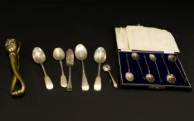 A Pair of Figural Brass Nutcrackers together with a cased set of spoons and assorted flatware.