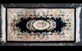 Oriental Style Wool Rug Rectangular runner of small proportion, black ground with central oval