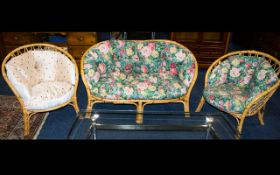 Three Piece Conservatory Suite Comprising two seater sofa and two tub chairs, caned frame of typical