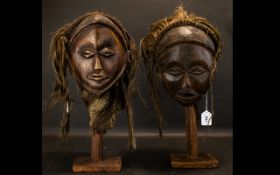 A Pair Of Oceanic Tribal War Masks Comprised of what appears to be coconut coir and human hair,