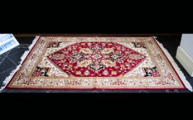 A Large Woven Silk Carpet Ornately patterned Heriz rug with iron red ground and traditional Middle