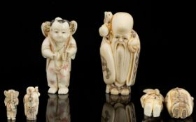 A Pair Of Carved Netsuke The first in the form of a sage in traditional robes,