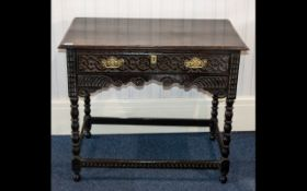 A Jacobean Style Side Table - oak side table with carved apron,
