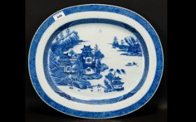 A 19th Century Oriental Oval Charger Large blue and white charger depicting pagodas and mountainous