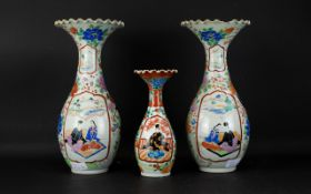 Three Oriental Japanese Vases Each with long neck and scalloped rim. Each with Imari style