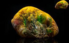 Large Carved Amber Style Oriental Boulder The front depicting scholars amongst prunus blossom,