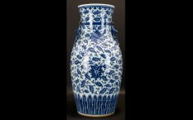 A Large Blue And White Oriental Design Twin Handle Baluster Vase Of typical form with stylised