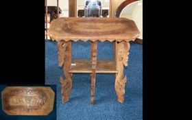 Indonesian Carved Wood Occasional Table. Rectangular Top And Stretcher.