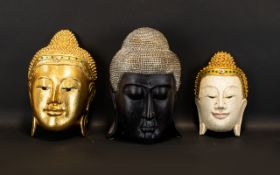 Three Modern Buddha Heads To include gilt and mirrored wall mask,