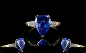 18ct Gold - Superb Quality Tanzanite and Diamond Set Ring.