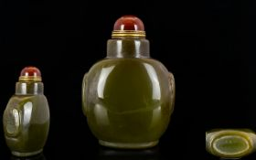 Oriental Agate Snuff Bottle Hardstone bottle of typical form with carnelian cabochon to top and