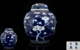 Antique Chinese Ginger Jar And Cover Blue and white with prunus design throughout, character marks