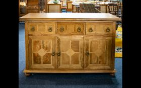 A Contemporary Mixed Wood 3 door, 3 drawer sideboard, raised on bun feet, Height 34 inches,