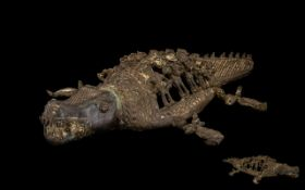 Antique Cast Bronze In The Form Of A Crocodile With figure in mouth The back,